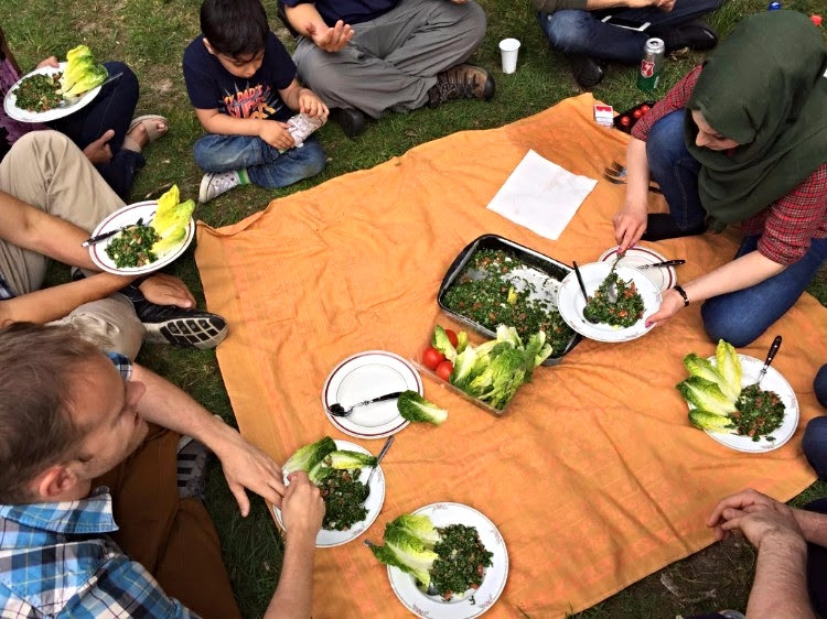 A picnic lunch shared between the Syrian refugee family who received Jesus after hearing the description of Christ in Revelation 1:13-16 and some people serving with the ETC team.