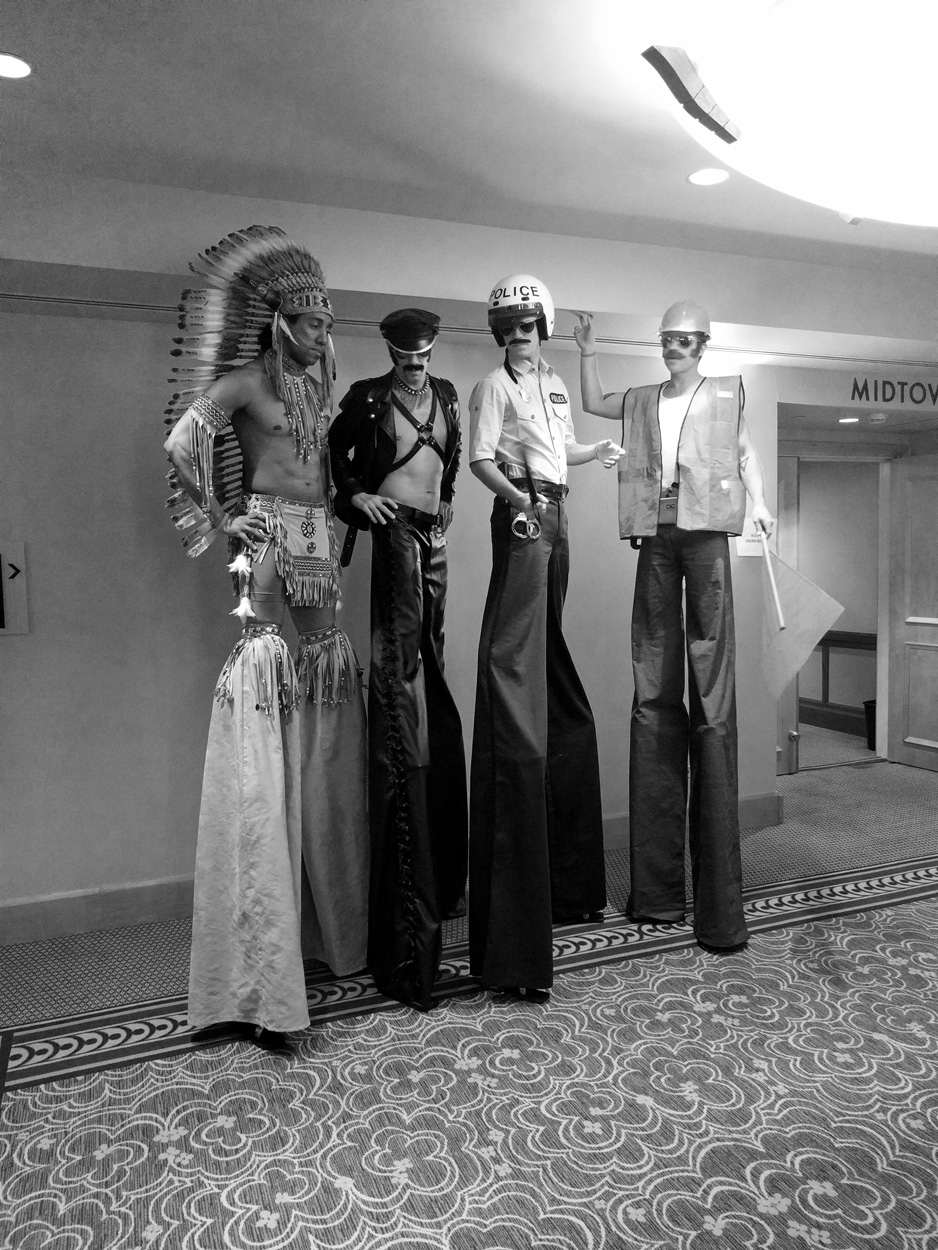 Village People look-alikes on stilts