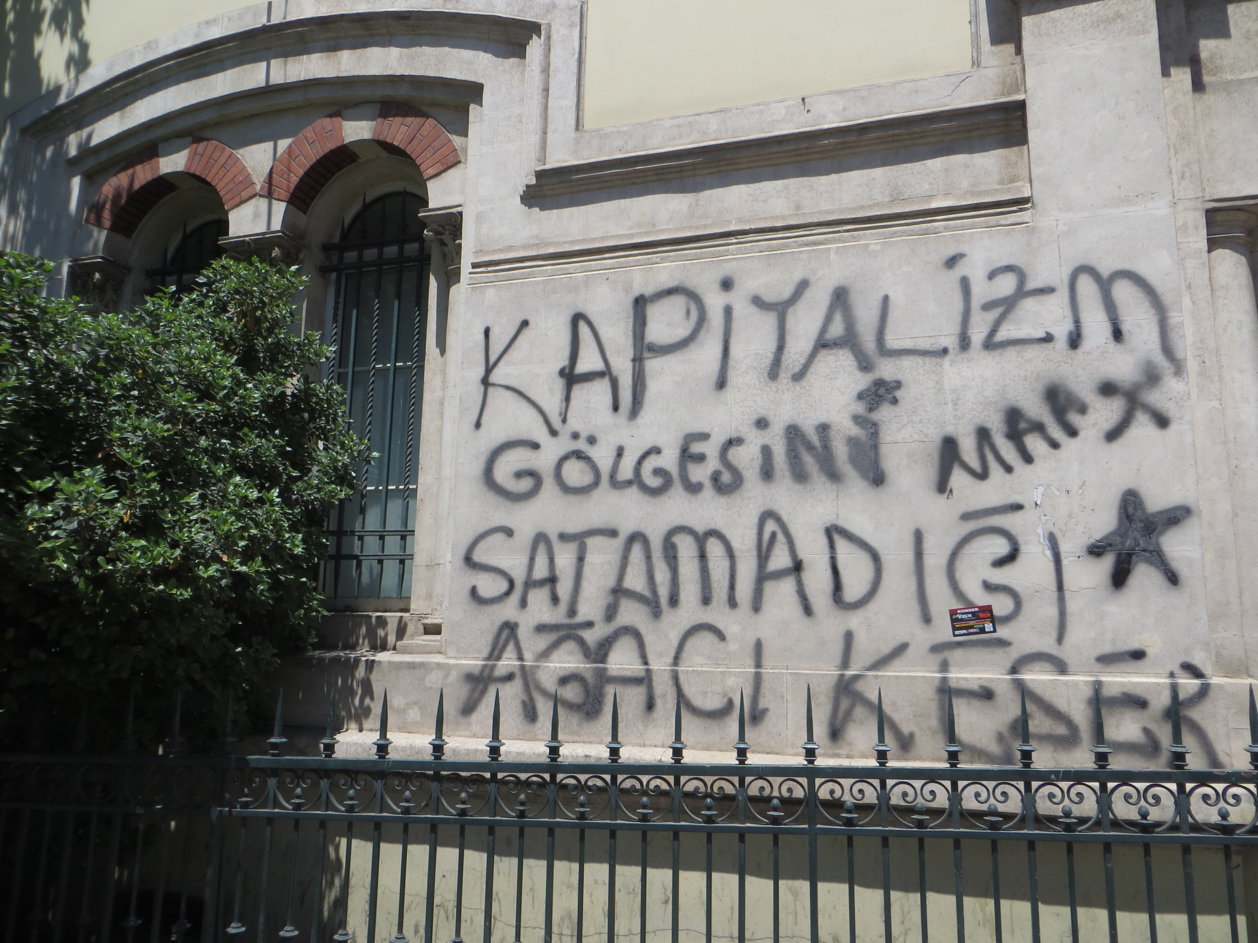 """Tree shadows do not stop capitalism"" spray painted on the French Consulate, adjacent to Taksim Square."