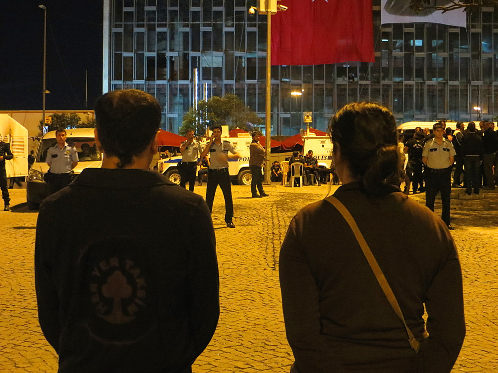 Protesters face up police in complete, unmoving silence in Istanbul's Taksim Square.