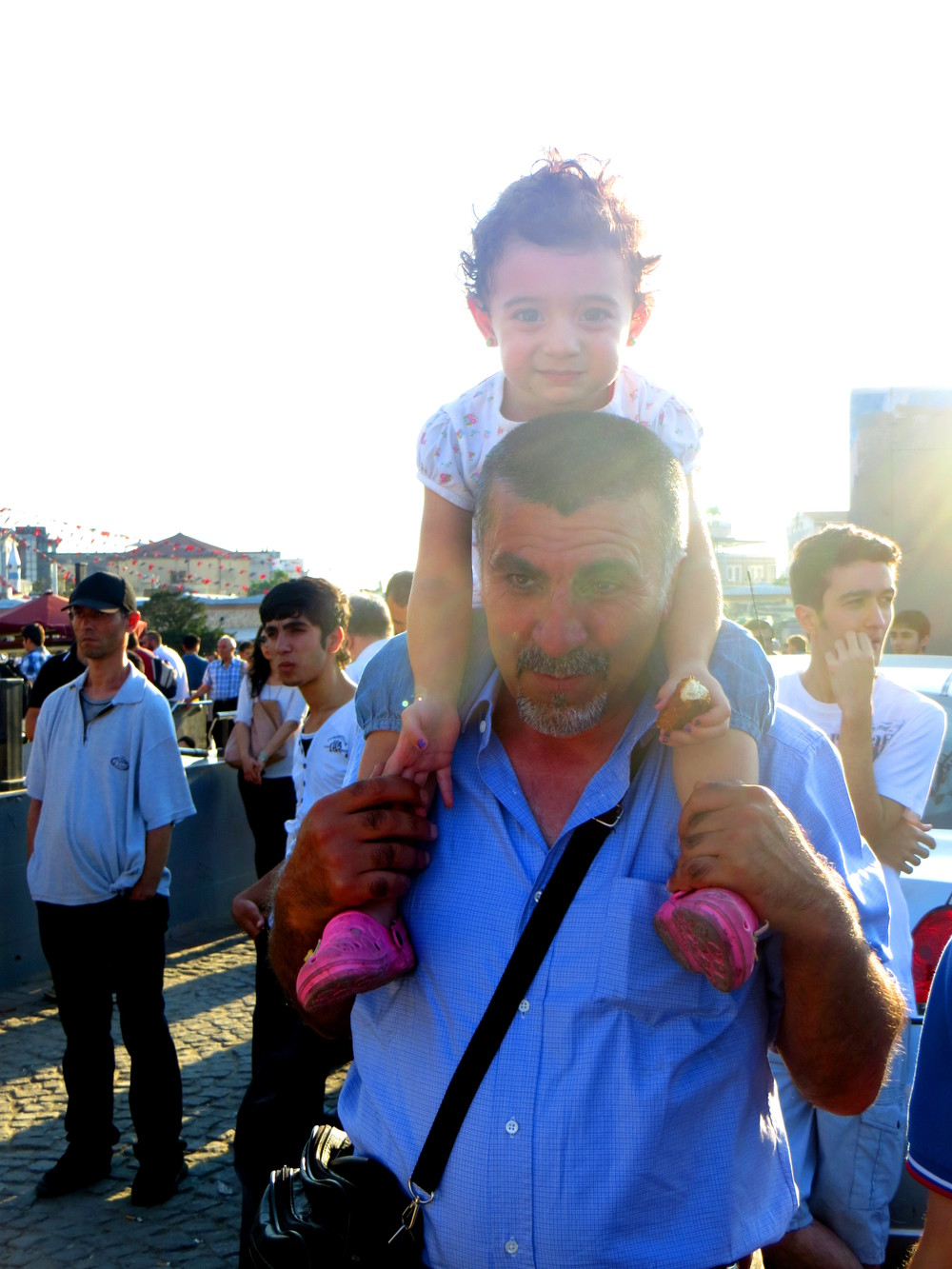A father brings his young daughter to the standing protests.