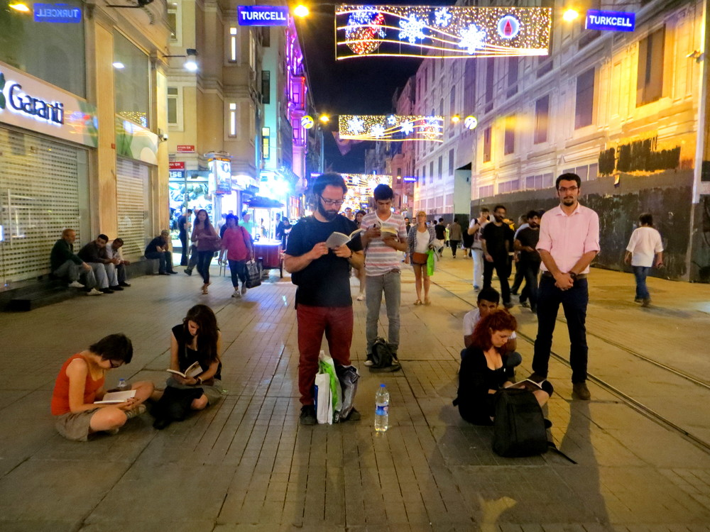Protesters read in silence on Istanbul's Istiklal Avenue in protest.