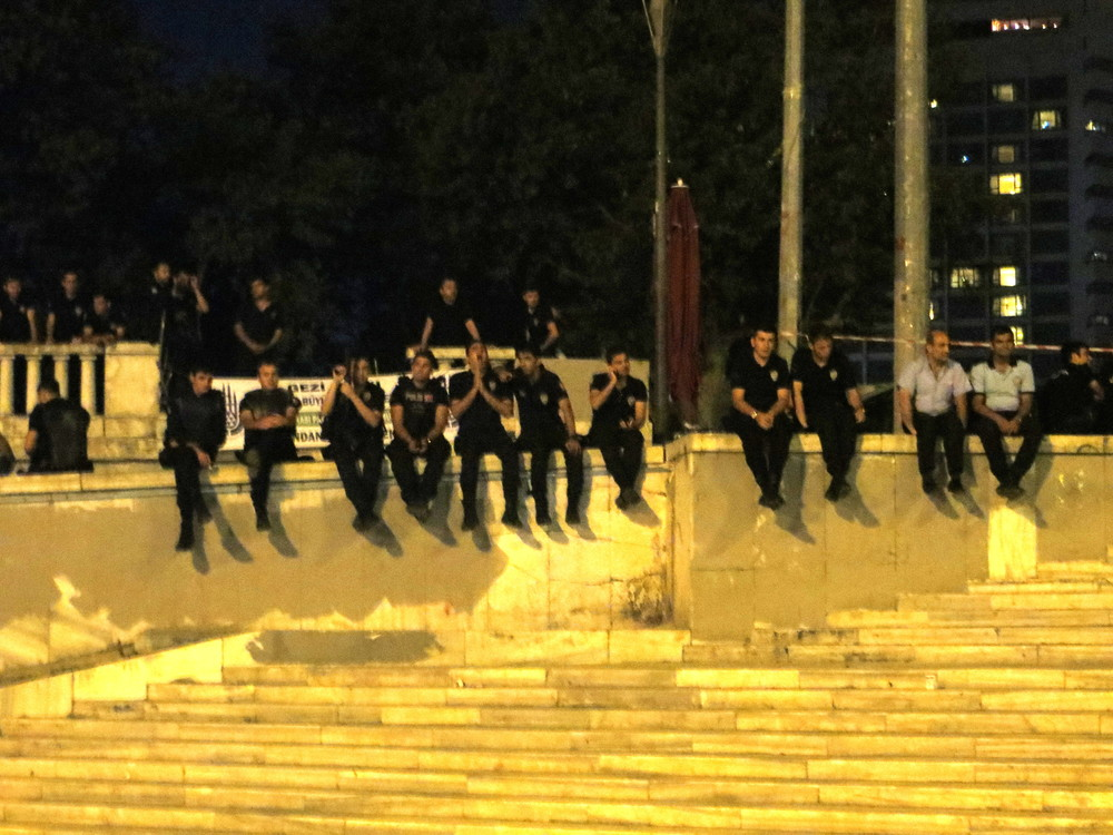 "Police look bored in Gezi Park, watching the ""standing man"" protests. Gezi remains closed to the public."