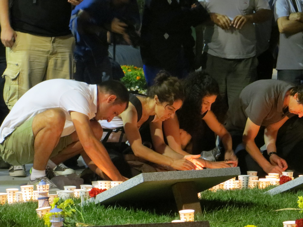 Visitors light candles in Gezi Park for the five killed in clashes with police.