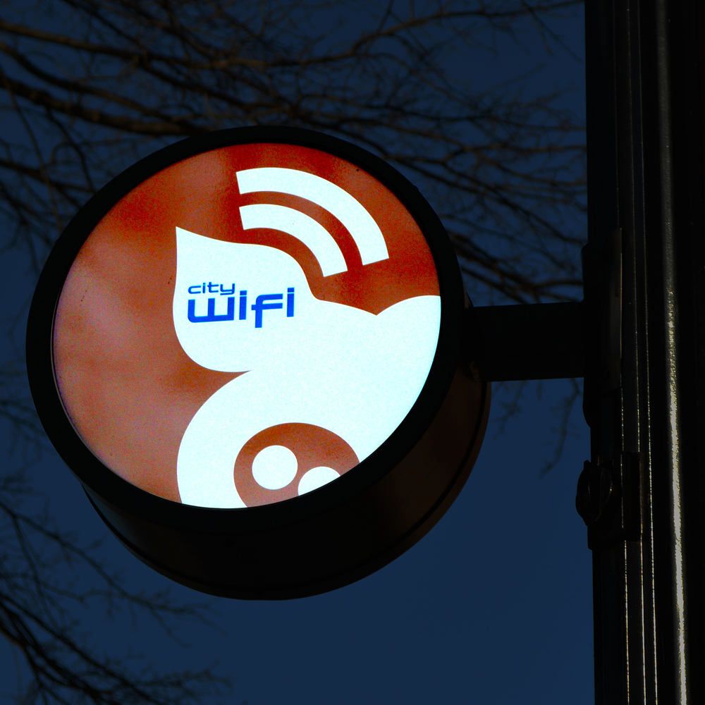 Environmental signage design creatively designates wifi perimeter area.