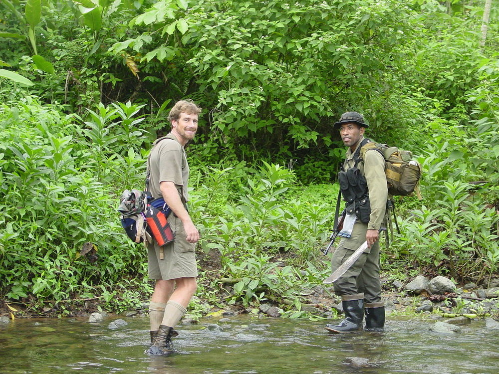 Leading a Smithsonian Tropical Research Institute field trip into the Darien with essential kit: boots (in this case US army issue), waterproof notebook (in the hip bag), machete (borrowed by my companion there, as it's more useful than a rifle, actually, in the jungle).
