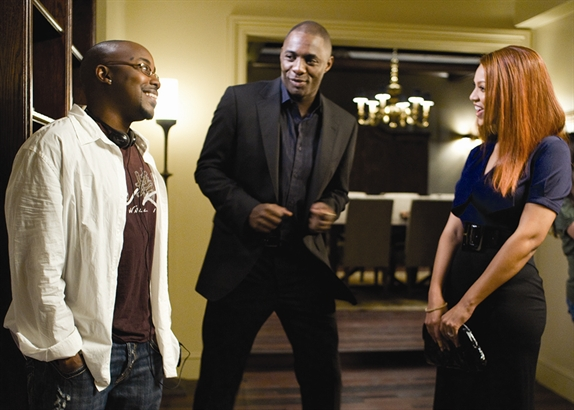 Producer Will Packer (left) on the set of Obsessed with cast members Idris Elba and Beyonce.
