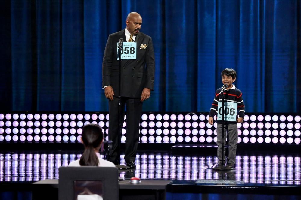 Steve Harvey and spelling bee champ Akash Vukoti. MUST CREDIT: Danny Feld, NBC