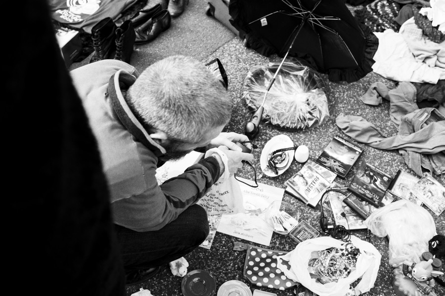 Street photography: A man searching for bargins at the Princess May boot fair