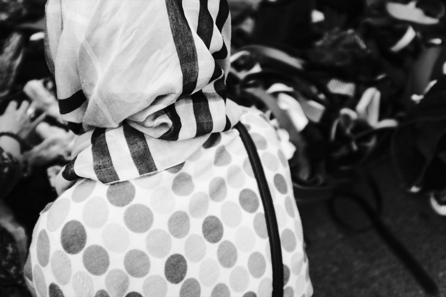 Street photography: A woman in a headscarf at the Princess May boot fair