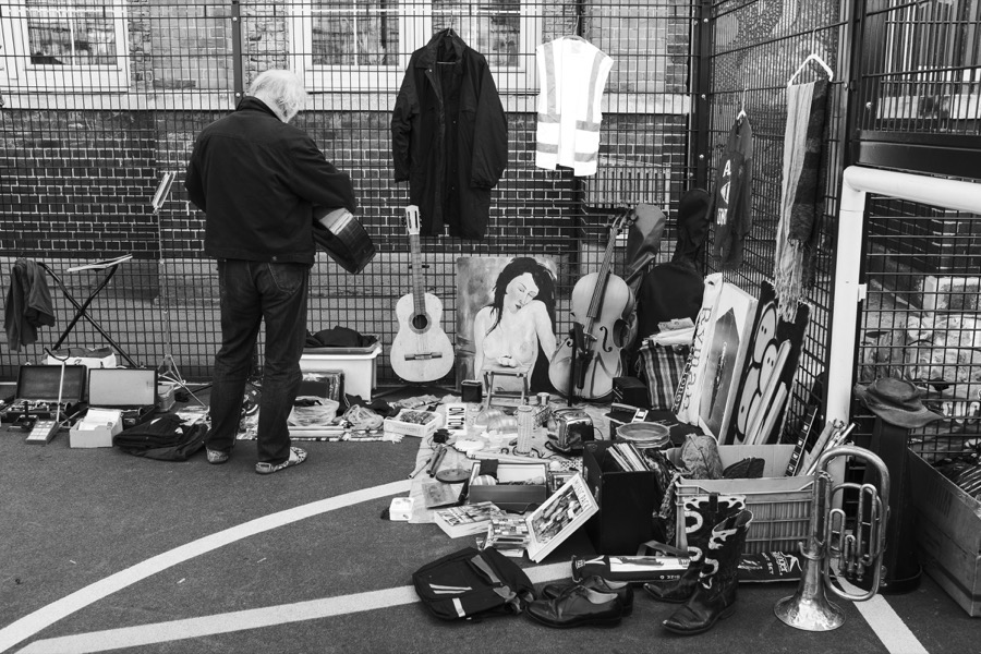 Man selling guitars at the Princess May boot fair