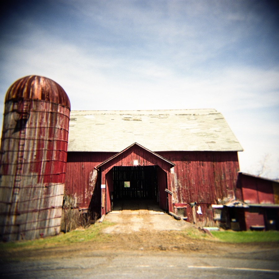 A tumbled down red barn in New York state