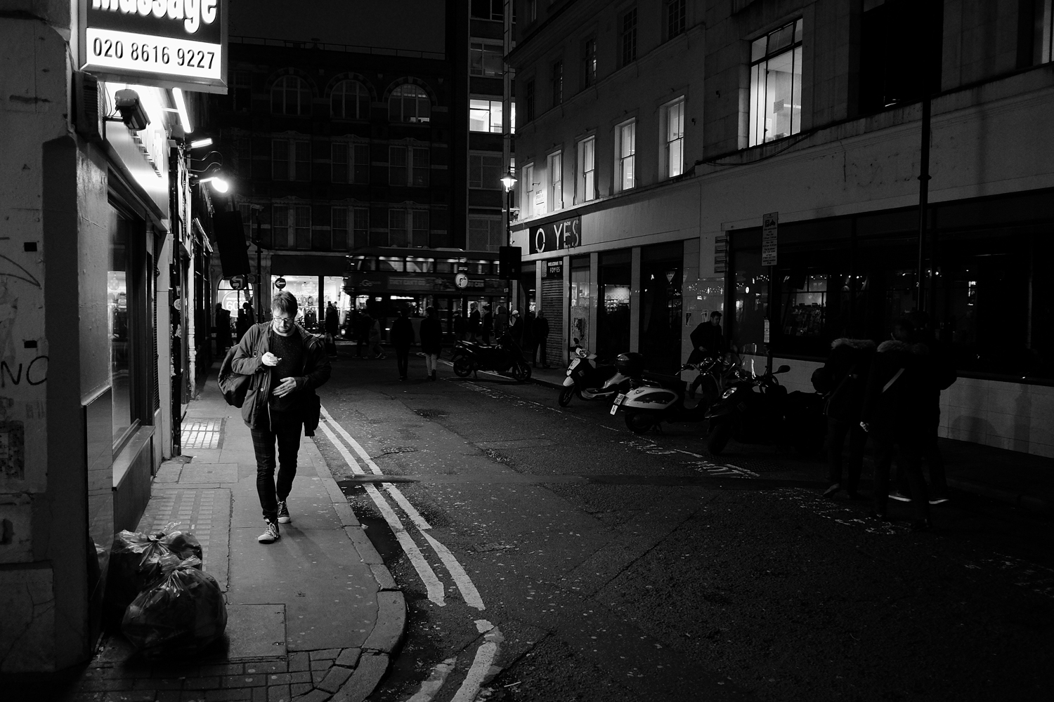Fujifilm X-T1 jpeg file of a darkly light London street scene