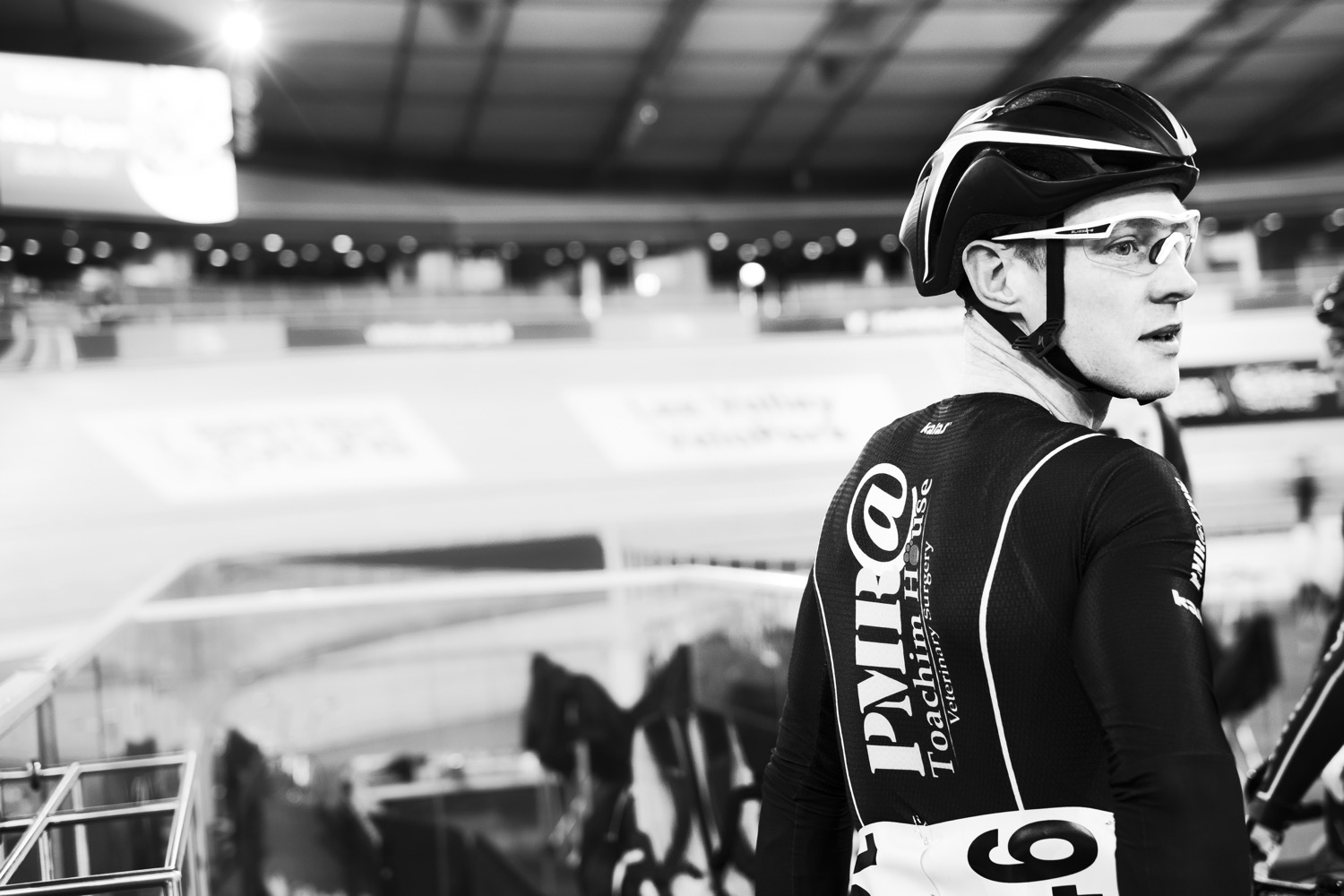 A track cyclist waiting to race at the London Olympic velodrome.