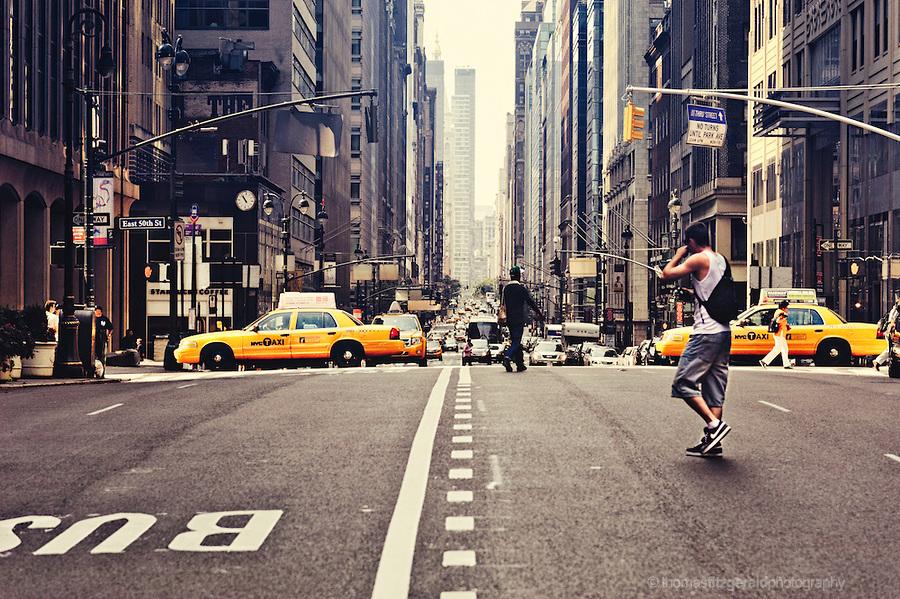 Guy Crossing Street in New York