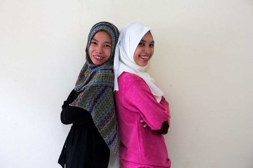 Our Administration and Communications Team: Kak Yenny (left), Kak Devya
