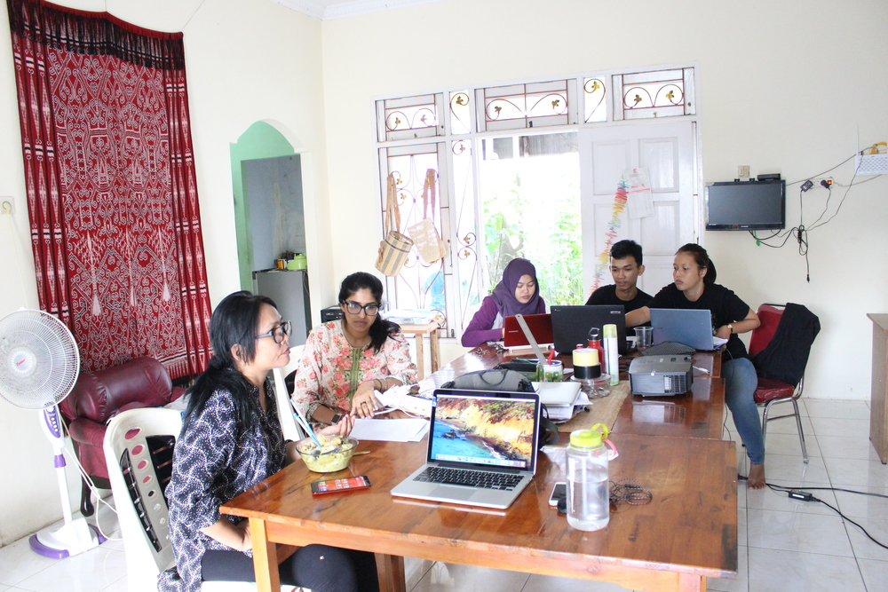 Planet Indonesia members discussing plans for a field trip