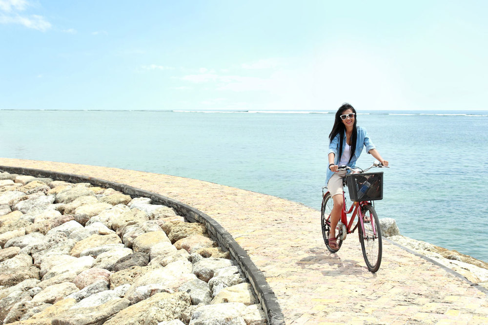 Girl-Riding-bike-On-North-Ave-Beach-Lake-Michigan-Lifestyle.jpg
