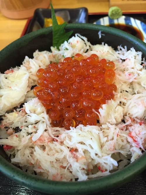 Crab meat and salmon roe on top of rice