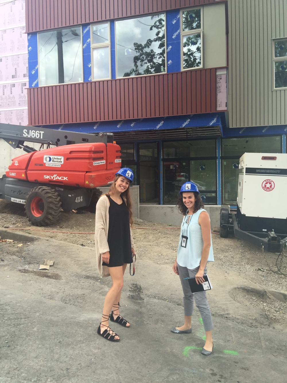 TIS Alumna Nehalem Kunkel-Read (Japanese, '09) and Alumni Coordinator Lisa Olivares tour Learners' Hall as it neared completion.  Alumni families were key supporters in completing the capital campaign to make Learners' Hall a reality.