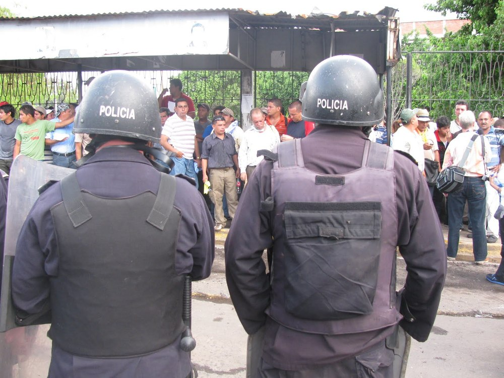 Police 'guarding' teachers and individuals they captured during violent eviction.