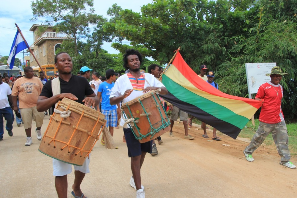 Photo caption: Marching from the Garifuna neighbourhood of Cristales in Trujillo to the courthouse