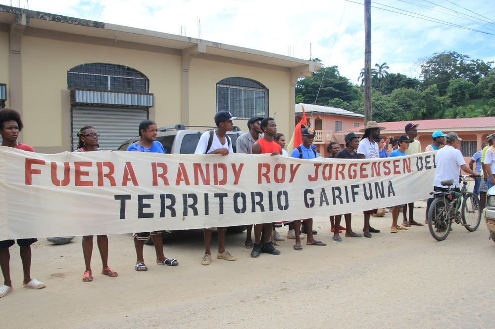 "Photo caption: Banner reads ""Randy Roy Jorgensen out of Garifuna territory."" All photos by Karen Spring"