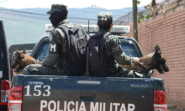 Military police personnel raid dwellings in search of leaders of the MS-13 gang in Tegucigalpa on 20 May 2016. Photograph: Orlando Sierra/AFP/Getty Images