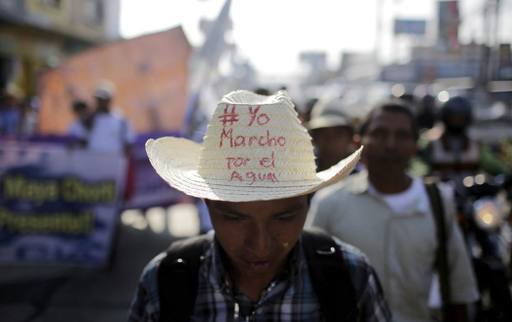 "An indigenous man wears a hat with text reading ""I March for Water"" during a protest to demand control over water resources in provincial areas, Guatemala City, Guatemala, April 22, 2016. (Reuters / Saul Martinez)"