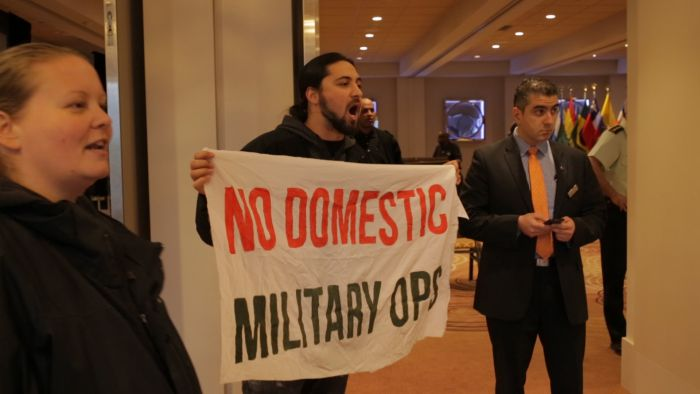 """No Domestic Military Ops"" banner protesting a military conference whose theme focused on ""domestic operations"". PHOTO: Michael Toledano. Photo taken from here"