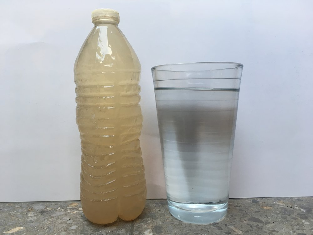 The water bottle on the left is a sample of water taken from inside La Tolva. When prison authorities do not provide sufficient purified water, prisoners must drink the dirty tap water