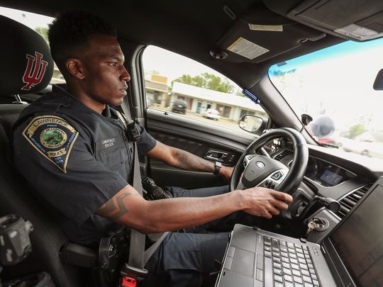 """Officer Devin Randle works a patrol shift for the Lawrence Police Department, Lawrence, Ind., Friday, April 21, 2017. Randle was an early-adopter of the department's three-camera system. Randle calls the body-worn cameras a """"de-escalation tool,"""" and has found an angry person being pulled over is more likely to calm down and cooperate if they know they are being recorded.(Photo: Jenna Watson/IndyStar)"""