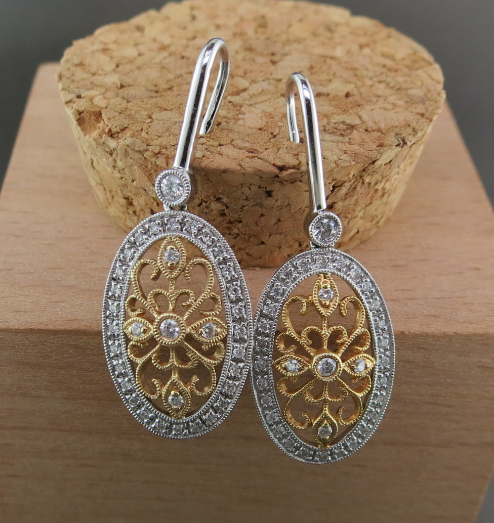 18 Karat White and Yellow Gold Dangle Earrings, accented with Diamonds