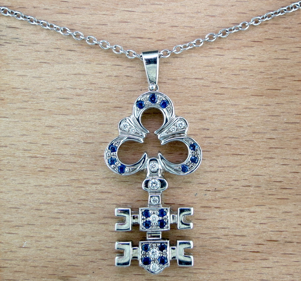 18 Karat White Gold, Sapphire, and Diamond Pendant on an 18 Karat White Gold Chain (MB385)