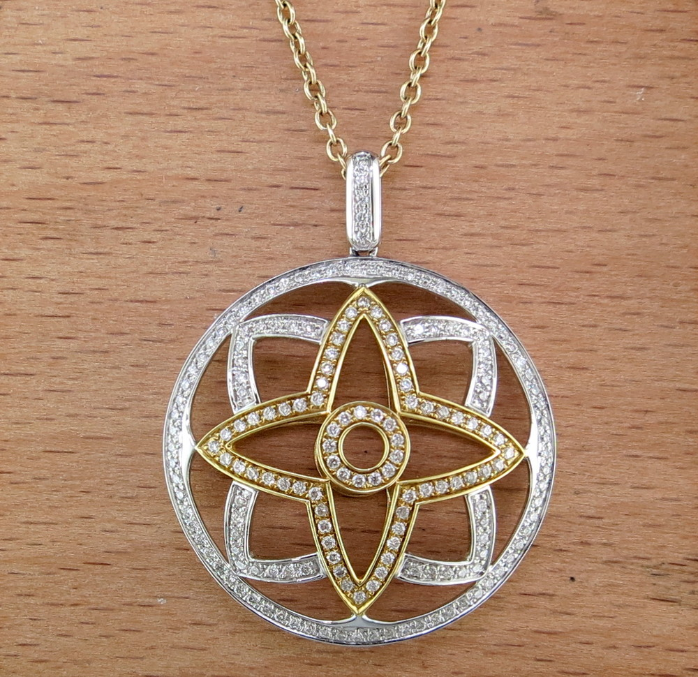 18 Karat White Gold, 18 Karat Yellow Gold, and Diamond Star Pendant on an 18 Karat Yellow Gold Chain (MB527/386)