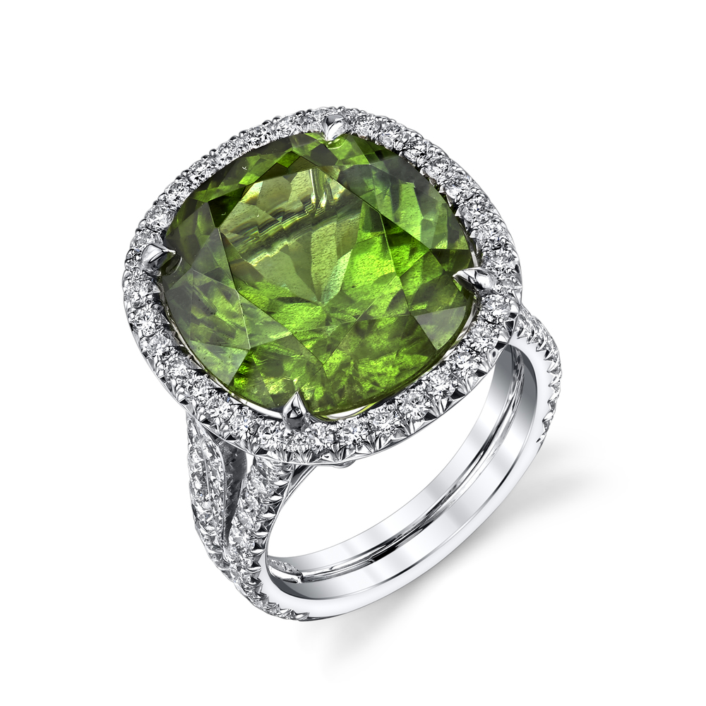 This vivid 18.02 CT Burmese Peridot stone is set in 18 Karat White Gold and studded with 1.88 CT White Diamonds.