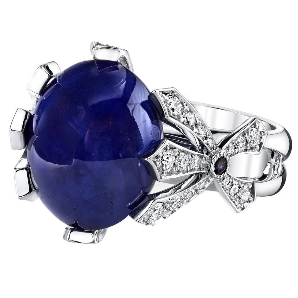 16.11 Ct Cabochon Sapphire set in 18 Karat White Gold and accented with 0.42 Ct Diamonds and 0.04 Ct Sapphires.
