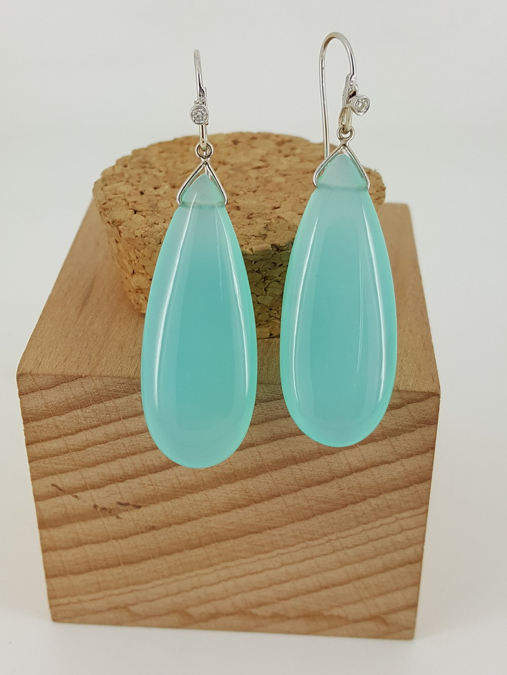 18 Karat White Gold Chalcedony Drop Earrings, accented with a diamond.