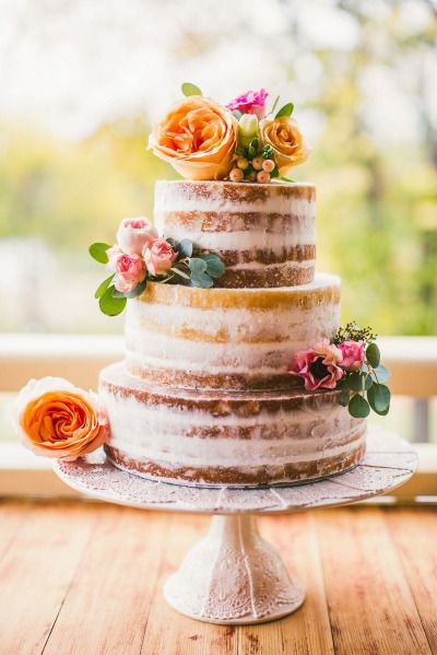 Naked cake with orange flowers