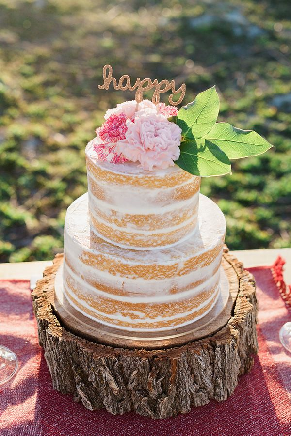 Naked cake with pink flowers and topper
