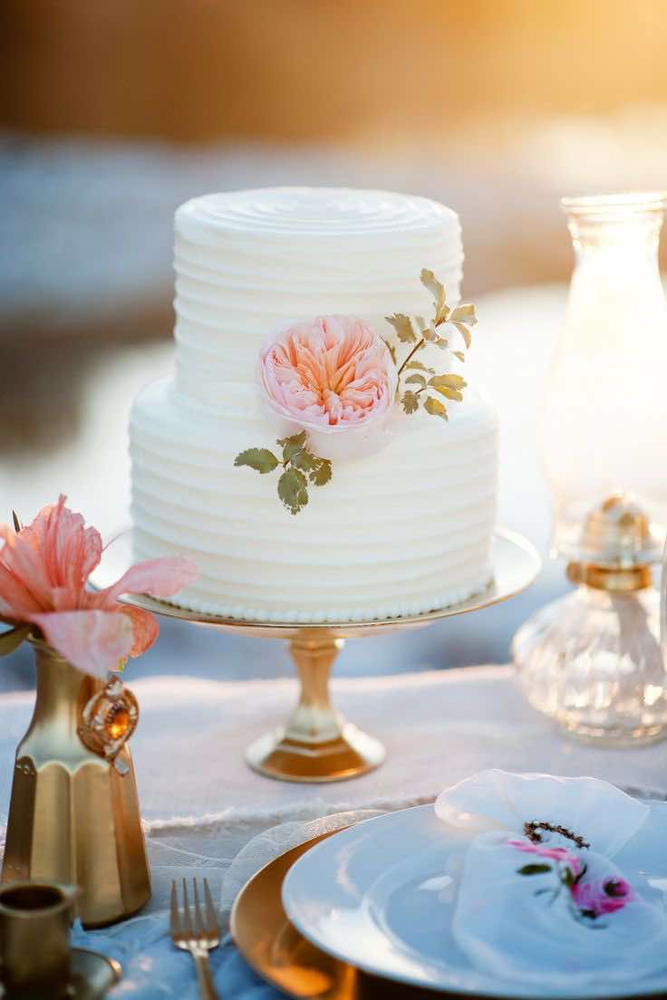 20 beautiful buttercream wedding cake ideas the bohemian wedding white wedding cake with pink flowers mightylinksfo