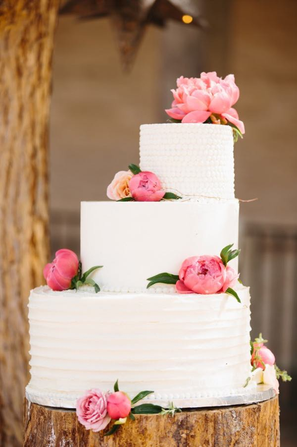 White Asymmetrical Wedding Cake with Peonies