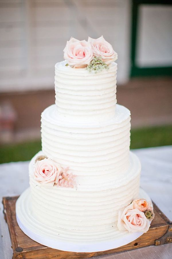 White Buttercream Wedding Cake with Pink Roses