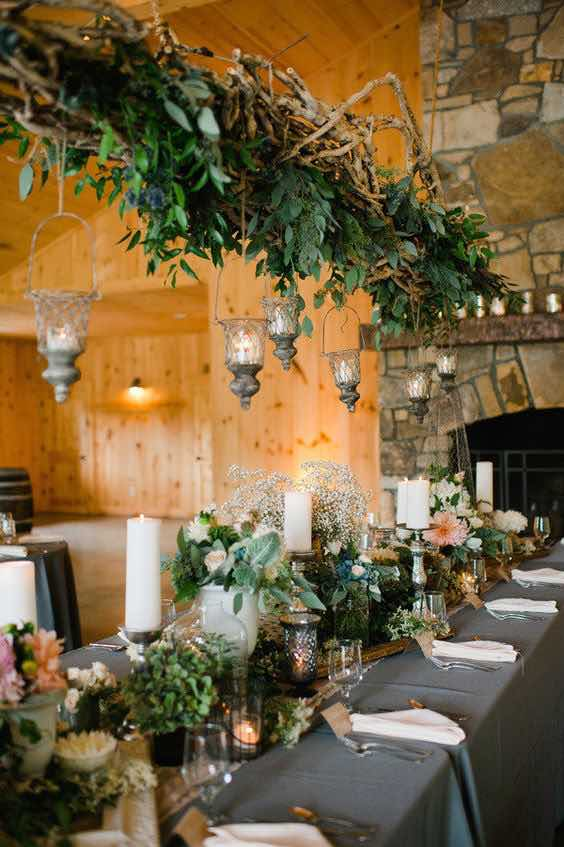Wood Beam with Rustic Greenery and Lanterns