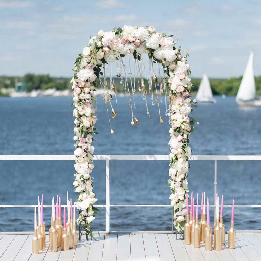 Wedding Arch With Flowers And Sailboats