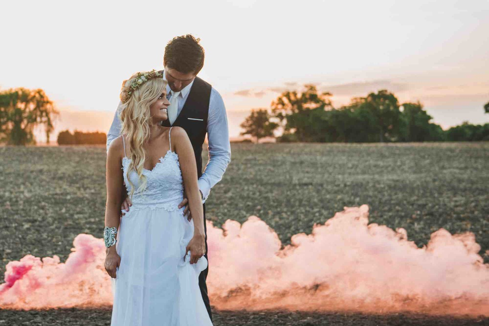 Pink smoke and boho couple