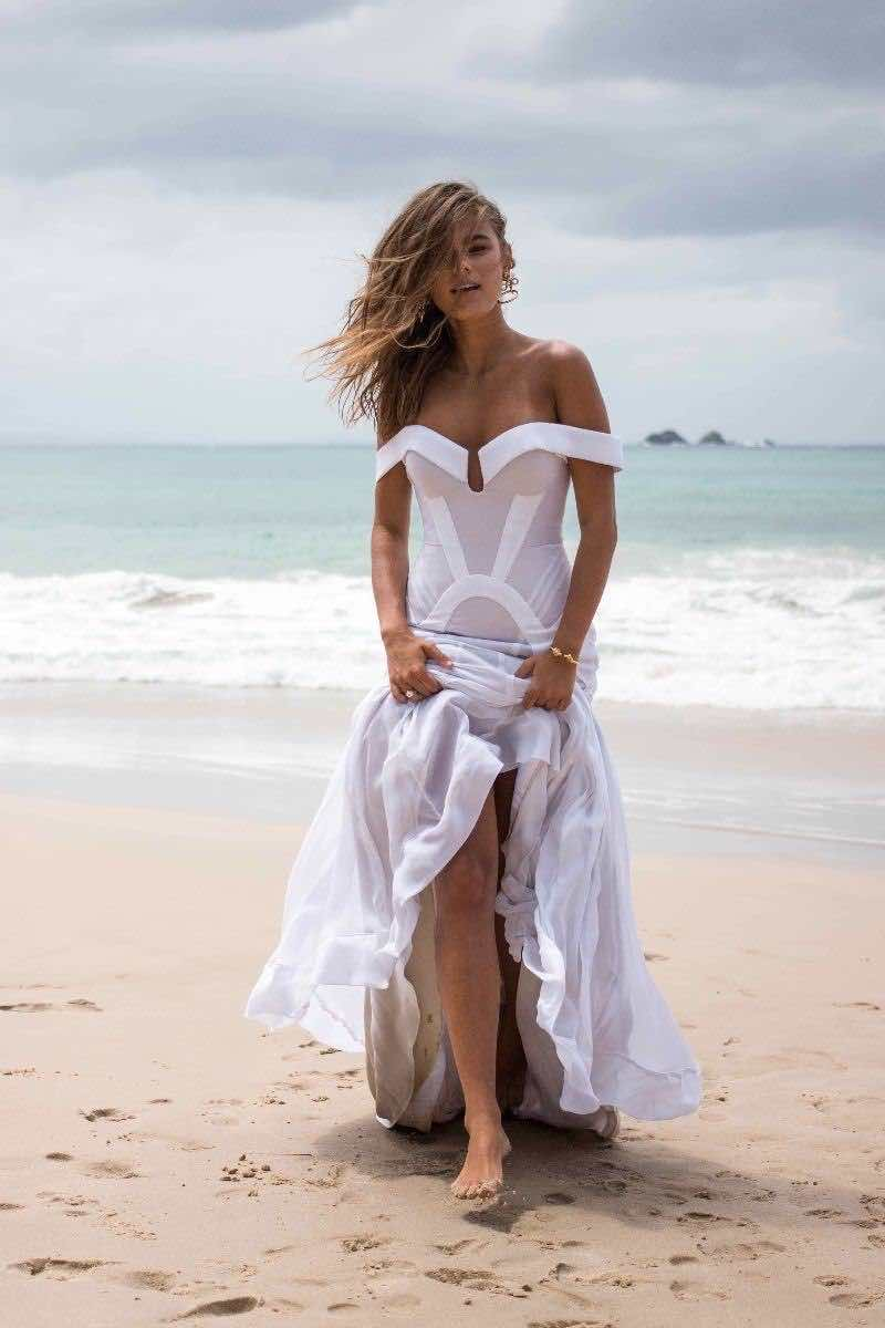 Georgia Young Couture White Dress Full with Feet in Sand