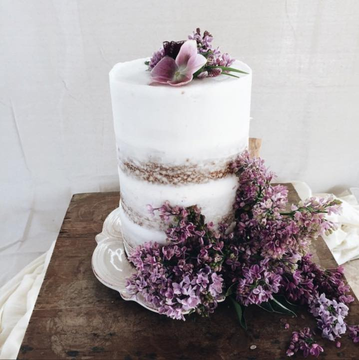 White Naked Wedding Cake with Minimalist Flowers
