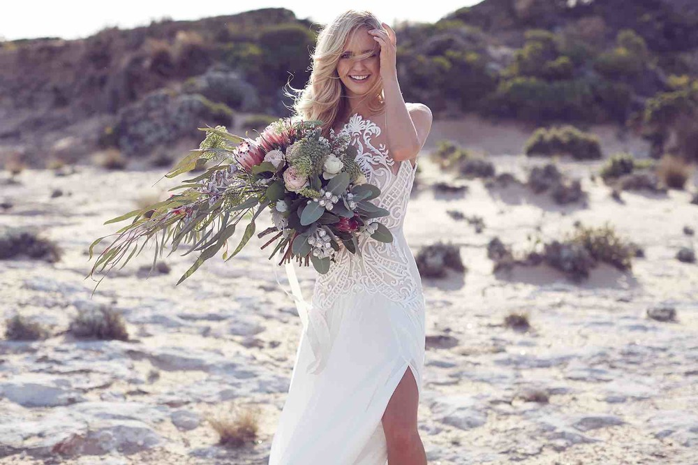 Lost in Love Photography - Bride with Wedding Dress and Bouquet