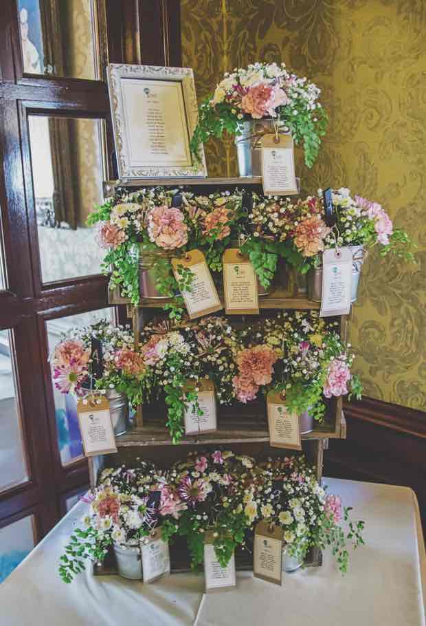 Wine Crate Display with Flowers and Tins for Table Plan